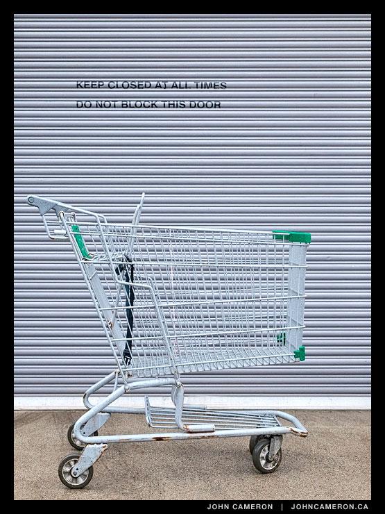 A shopping cart blocks the door.