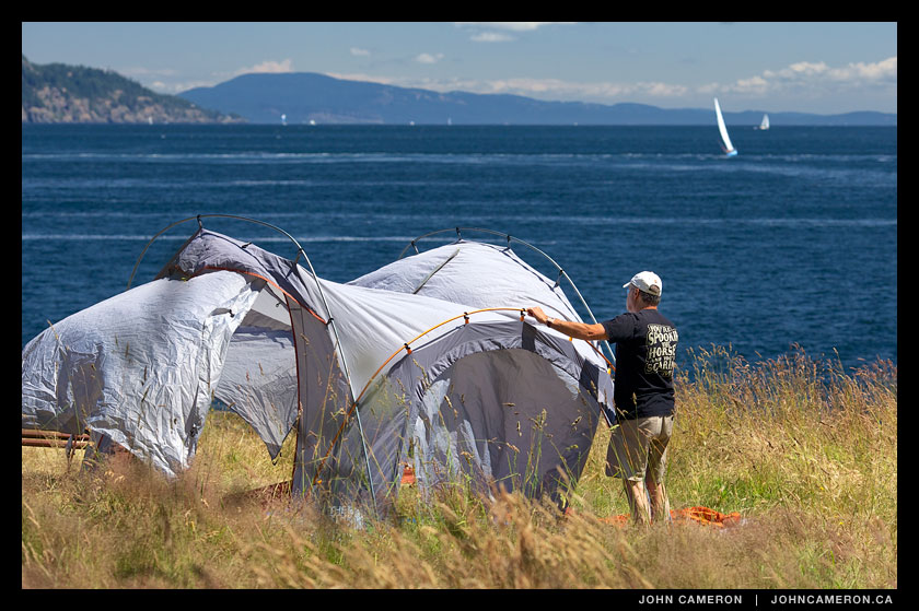 Camper pitches a North Face tent at Ruckle Park, Salt Spring Island