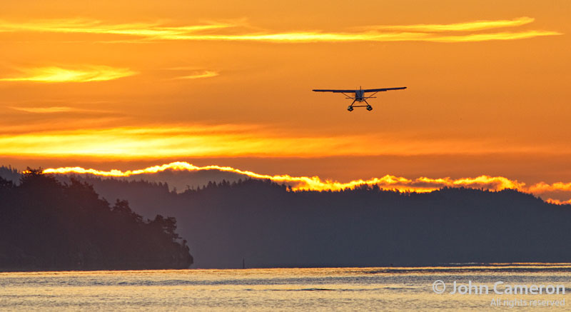 Float plane leaves Ganges Harbour at sunrise