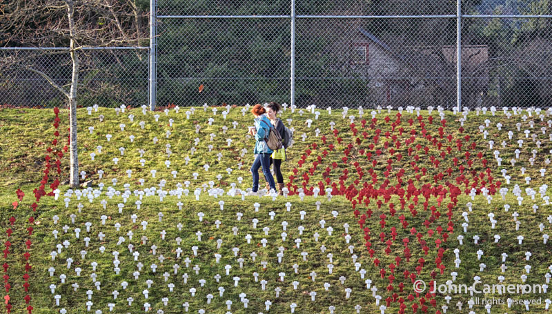 students walk through AIDS crosses at GISS