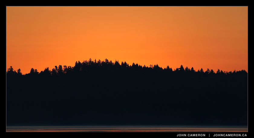 An orange sunrise photo from salt spring island